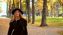 Girl runs towards the camera and smiles Stock Footage