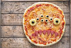 Halloween creative scary food monster zombie face with eyes pizza snack Kuvituskuvat