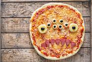 Halloween creative scary food monster zombie face with eyes pizza snack Stock Photos