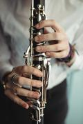 Woman playing a clarinet in music school Stock Photos