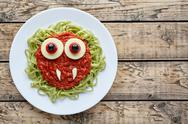 Green spaghetti pasta creative halloween food vampire monster with fake blood Stock Photos