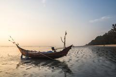 Fishing boat on Maungmagan Beach at sunset, Dawei, Tanintharyi Region, Myanmar Stock Photos