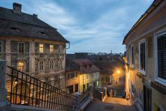 Sibiu, a 12th century Saxon city at night, Transylvania, Romania, Europe Stock Photos