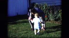 1951: father playing with his son in the garden of his house Stock Footage