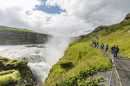 Tourists visiting Gullfoss (Golden Falls), a waterfall located in the canyon of Stock Photos