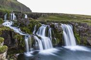 Waterfall near Kirkjufell (Church Mountain), just outside the town of Stock Photos