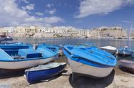 Fishing boats at the port, old town with castle, Gallipoli, Lecce province, Stock Photos