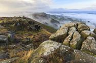 Early morning fog, Curbar Edge with view to Baslow Edge, Peak District National Stock Photos