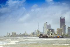 The Haji Ali mosque and the skyline of central Mumbai under monsoon seas, Mumbai Stock Photos