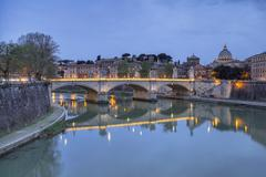 Dusk on Tiber River with Umberto I Bridge and the Basilica di San Pietro in the Stock Photos