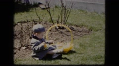 1951: beautiful little boy entertained with his toys in a field day CLEVELAND Stock Footage