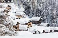 The snowy woods frame the typical mountain huts, Bettmeralp, district of Raron, Stock Photos