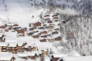 Snowy woods frame the typical alpine village and ski resort, Bettmeralp, Stock Photos