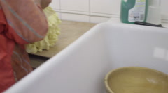 Woman Farmer making butter with butter churn Stock Footage