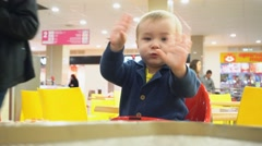 Cute child with my family eats at a cafe Stock Footage