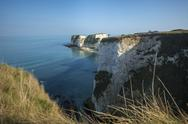 A woman looks out at Old Harry Rocks at Studland Bay in Dorset on the Jurassic Stock Photos