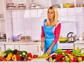 Woman show how cooking vegetable at kitchen. Stock Photos