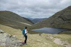 Looking towards Styhead Tarn on the trail towards Great Gable and Scafell Pike Stock Photos