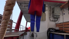 Diver suit dries on the stern of the research vessel Stock Footage