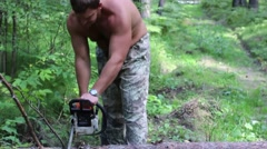 Lumberjack sawing wood chopping ax and chainsaw Stock Footage