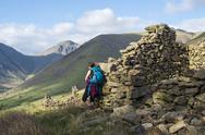 Crumbling stone houses in the English Lake District in Wast Water with views of Stock Photos