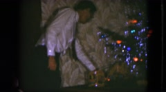 1951: a man is getting ready to celebrate the holidays with fun decorations. Stock Footage