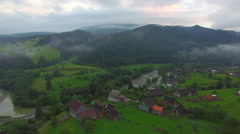 Low flying drones in the mountain village Stock Footage