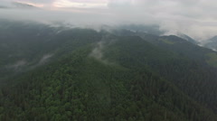 Clouds in the mountains. aerial footage Stock Footage