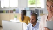 Closeup of customer service manager standing in call center Stock Footage