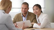 Cheerful married couple meeting financial adviser Stock Footage