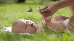 Mom gives a flower to his newborn child. Stock Footage