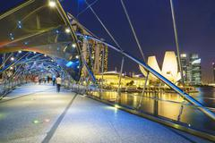 People strolling on the Helix Bridge towards the Marina Bay Sands and ArtScience Stock Photos