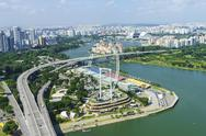 High view over Singapore with the Singapore Flyer ferris wheel and ECP Stock Photos