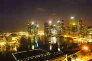 The towers of the Central Business District and Marina Bay by night, Singapore, Stock Photos