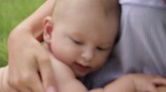 Mother cuddle a newborn Stock Footage