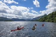 Canoes on Derwentwater, view towards Borrowdale Valley, Keswick, Lake District Stock Photos
