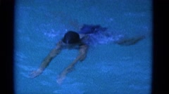 1953: teenage girl swimming breaststroke in pool NEW YORK Stock Footage