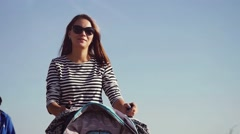 Young mother in sunglasses walking with her baby and carries it in a beautiful Stock Footage
