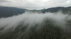 Fog in the mountains. aerial footage Stock Footage