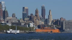 Long shot of Hudson river traffic with Staten Island Ferry on a background in Stock Footage