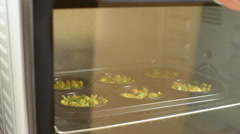 Hot tasty muffins with broccoli for dinner. Cooking concept Stock Footage