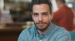 Portrait of Hispanic Ethnicity Young Man at Cozy Coffee Shop. Stock Footage