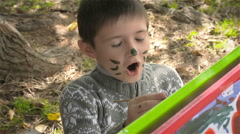Six-year-old boy draws paints on whatman paper and smiling Stock Footage