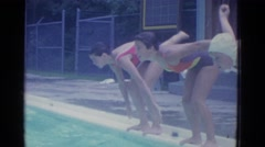 1953: three girls practice diving into blue pool for swim races NEW YORK Stock Footage