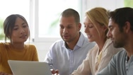 Business workgroup interacting in office Stock Footage