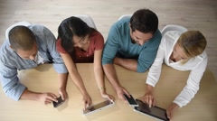 Upper view of start-up business people meeting with electronic devices Stock Footage
