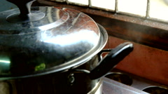 Cooking chicken wing  steam in a pot motion scene Stock Footage