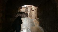 Woman with umbrella in a rainy day, Mora de Rubielos, Gúdar-Javalambre, Spain Stock Footage
