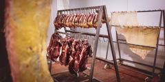 Beef heart and meat hanging in the storage room Stock Photos