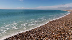 Waves lap on the shore of the English Channel Stock Footage